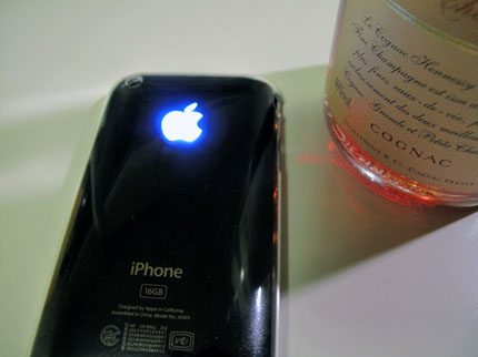 iPhone 3GS with an illuminating Apple Logo.